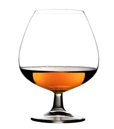 Glass with cognac on white background isolated. Front view. Close up shot. High resolution Foto de archivo