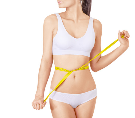 white underwear: Slim woman in white underwear and measure around her body on isolated background. Healthcare, diet, weight loss and body care concept. Without face
