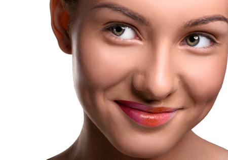 close up   head: Close up head shot. Young smiling woman with colorful lips make up on isolated white looking at the side Stock Photo