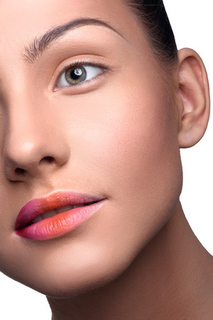 close up   head: Half face of beautiful, young woman with pure skin with colorful lips makeup. Close up head shot Stock Photo