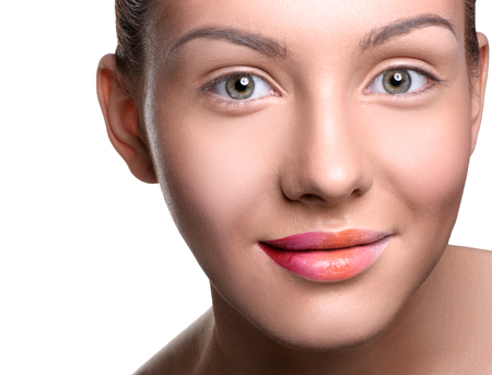 close up   head: Close up head shot of beautiful young woman with colorful lips makeup on isolated white looking at the camera Stock Photo