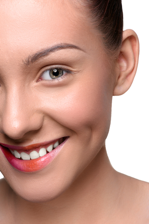 close up   head: Half face of cheerful, happy young woman with colorful lips makeup looking at the camera. Close up head shot Stock Photo