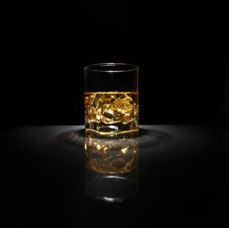 Luxury still life of whisky glass. Copyspace