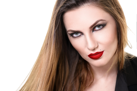 sexy vampire: Sexy Beauty Woman with Red Lips. Provocative Make up. Fashion shot isolated on a white background. Gorgeous Woman Face. Long Hair