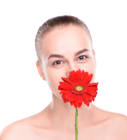 scincare: Cheerful beautiful woman hiding over red gerbera. Isolated on white background.
