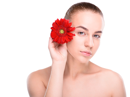 herbera: Beautiful woman with red gerbera. Isolated on white background.