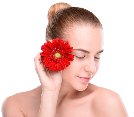 flower head: Beautiful woman with red gerbera. Isolated on white background.