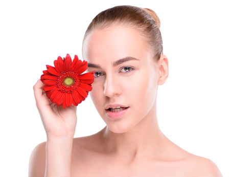 scincare: Woman posing with red gerbera. Isolated on white background.