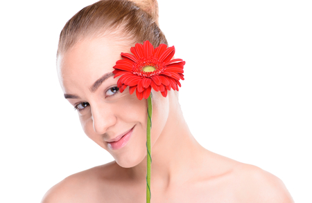 herbera: Cheerful beautiful woman with red gerbera. Isolated on white background. Stock Photo