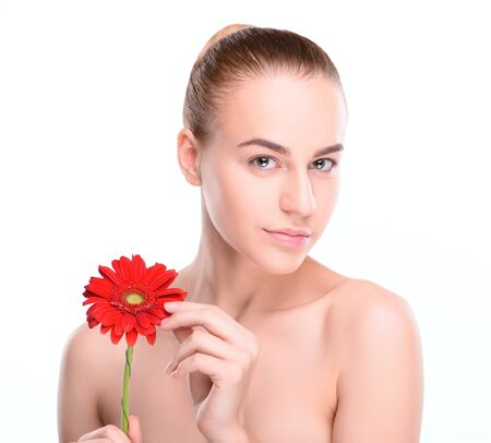 scincare: Beautiful woman with red gerbera. Isolated on white background.