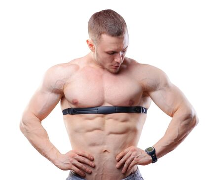 trainer device: Shirtless athlete man posing with heart rate watch isolated on white.