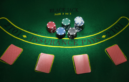 lear: Cards and chips for poker on green table, top view.