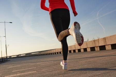 Close up shot of running woman. Selective focus.