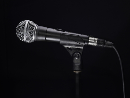 Microphone on black background. Side view shot Stock Photo