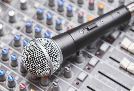 Microphone on sound mixing console. Close up shot