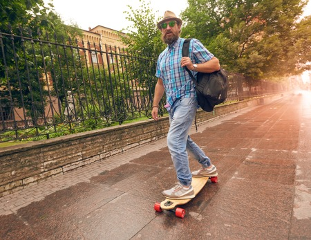 Man riding on longboard in the streets urban, setting of lifestyle concept Stock Photo