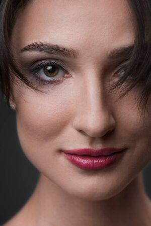 Close up portrait of young smiling woman. Red lips Imagens - 133398114