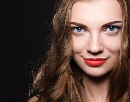 Beautiful caucasian young woman with red lips make up