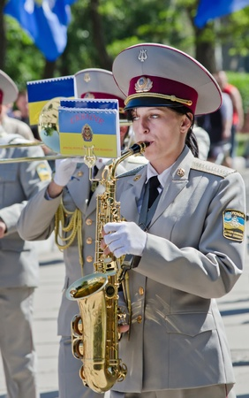 Female saxophone, brass band , performer