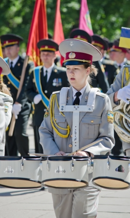 Brass band, female drummer.  Army, brass band, female drummer, performer, one, musician