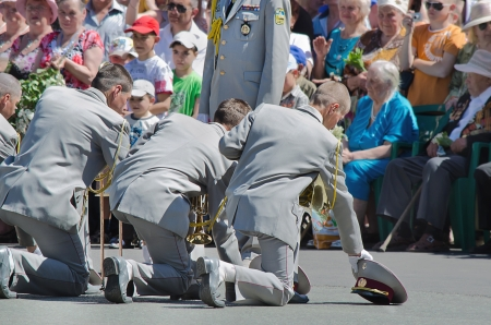 Victory Day, May 9. Men, were, on one knee, in front of the veterans, respect