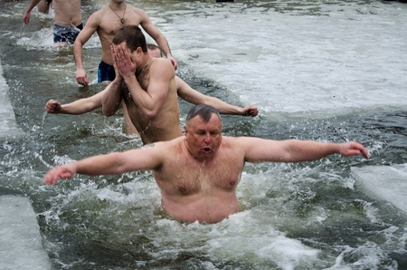 Bathing in the river in winter, in the hole