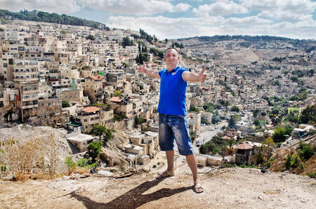 Cityscape   A man stands on a background of the ancient city of Jerusalem   Israel  Holy Places photo
