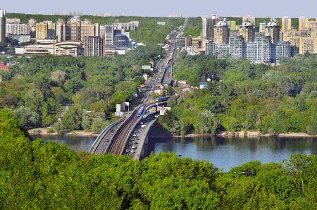 river scape: Beautiful spring city scape. New bridge across the Dnieper River. The capital of Ukraine, Kiev