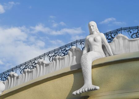 architectural feature: Mermaid sitting on the roof. Attraction, architectural feature, city of Odessa, Ukraine