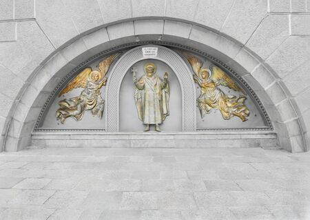 cues: St. Vladimir and angels. The bas-relief on the site of the Baptism of Kievan Rus, near the Dnieper River Stock Photo