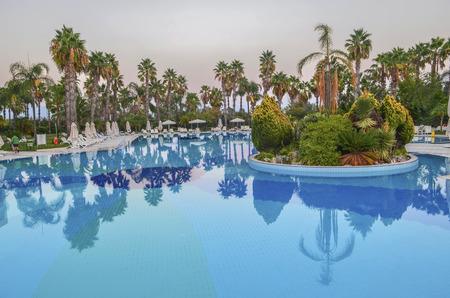 recreation area: Turkish landscape. Swimming pool, palm trees, park recreation area Editorial
