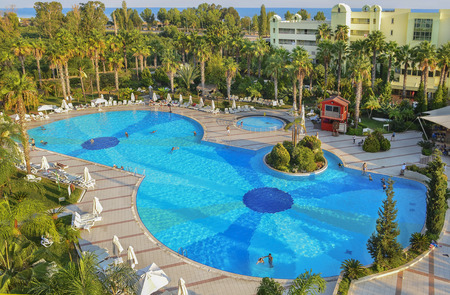 recreation area: Relax in the Turkish hotel. Large swimming pool, palm trees, park recreation area. Kemer, Turkey