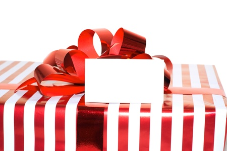 Christmas Present with Ribbon and tag. Isolated on white background Stock Photo - 15813329