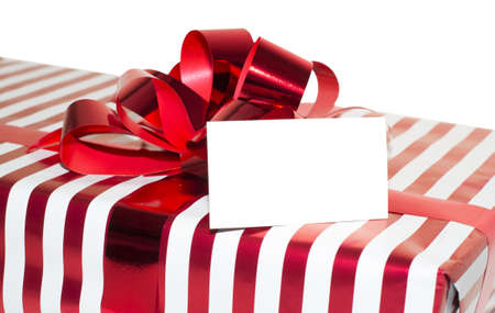Christmas Present with Ribbon and tag. Isolated on white background Stock Photo - 15809722