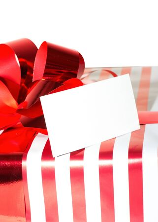 Christmas Present with Ribbon and tag. Isolated on white background Stock Photo - 15813330