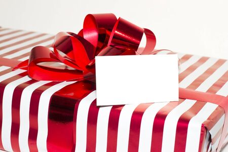 Christmas Present with Ribbon and tag  Isolated on white backgro Stock Photo - 16188439