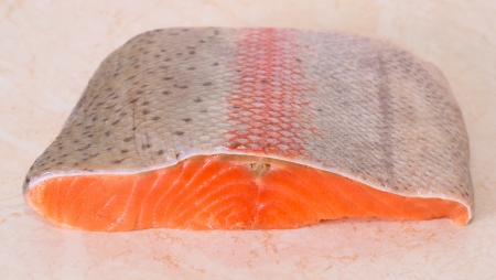 Salmon fillet on wooden background Stock Photo - 16325052