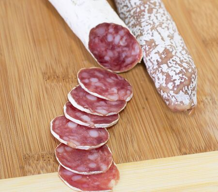 Culinary traditional spanish sausages on wooden  background  photo