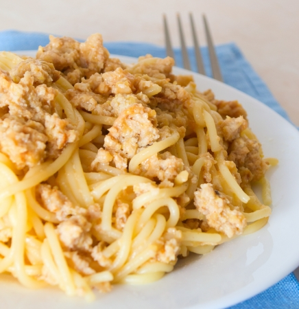 Pasta with minced meat and onions photo