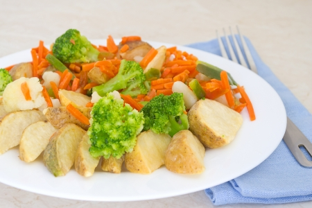 Mixed vegetables on a plate with fork photo