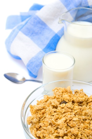 Close-up of a bowl of cereal with a jug of fresh milk, isolated Stock Photo - 17707704