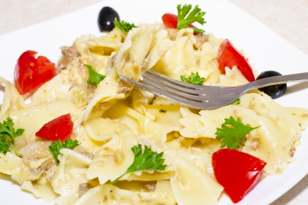 Pasta ribbons, cherry tomatoes and olives photo