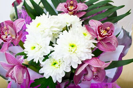 Bouquet of orchids and chrysanthemums isolated on white background photo