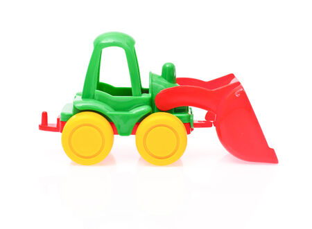 toy tractor isolated on white  photo