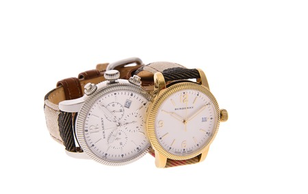 clockwise: Minsk, Belarus - February 12, 2015: Burberry Mens and Womens Watches Isolated