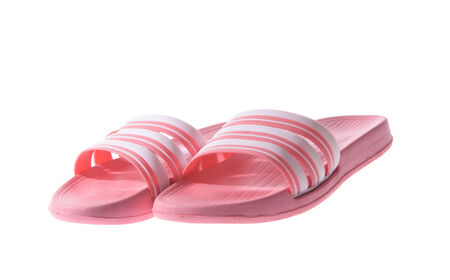 tossing: Pink Rubber flip flops. Isolated