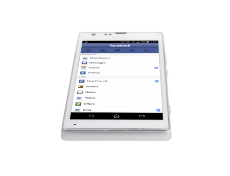 sony: Minsk, Belarus - March 14, 2015: Facebook on the Screen Smartphone Sony Xperia SP Isolated on White Background