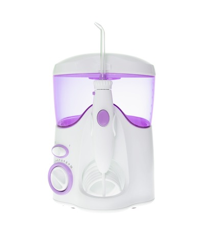 irrigator: Brushing Teeth, Massage Gums. Irrigator for Oral Cavity Cleaning. Isolated