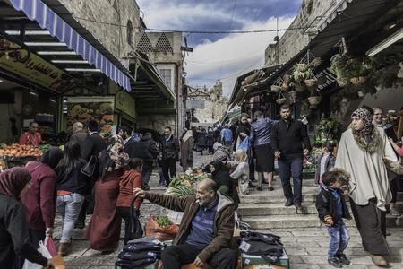 Jerusalem, Israel - December 04,2016: People are walking through crowded streets of Jerusalem converted to huge outdoor shop
