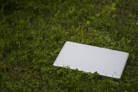 urban environment: Laptop sunny summer day in the urban environment. Stock Photo